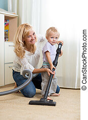family have fun with cleaning carpeting - housework