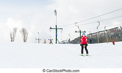 Winter sports, skier using ski lift