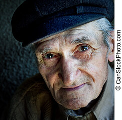Artistic portrait of friendly senior old man - Artistic...