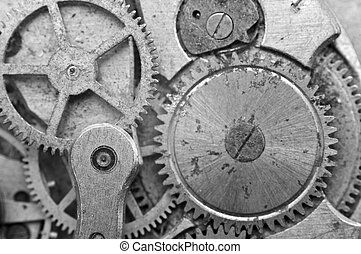 Black-and-white Metal Cogwheels in Oldest Clockwork, Macro....