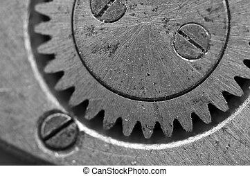 Black-and-white Metal Cogwheels in Oldest Clockwork, Macro....