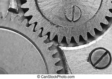 Black-and-white Metal Cogwheels in Clockwork. Macro -...