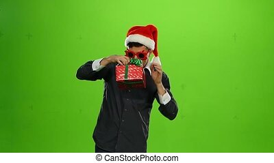 positive man with a gift. green screen. Slow motion -...