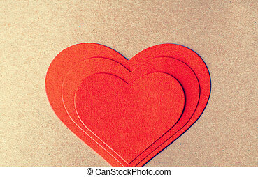Stach of red paper heart on each other. Card for a Valentine's day