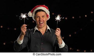 New year celebrating man holding sparkles. Slow motion -...