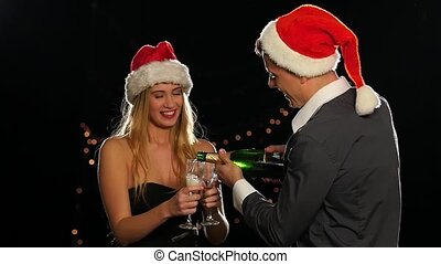 emotional happy couple opening champagne on New Years eve...