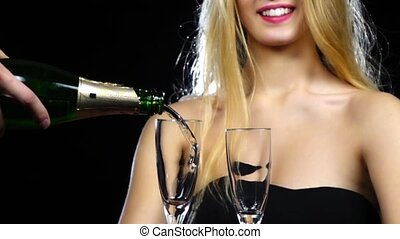 Man pours champagne into two glasses. Slow motion. Close up...