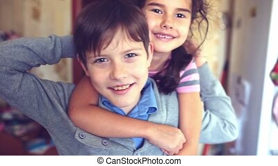 happiness boy girl hugging shout brother and sister -...