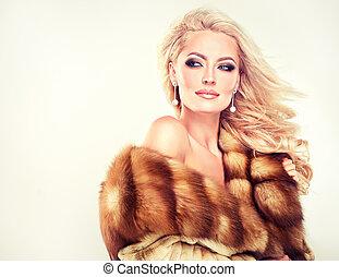 Winter Woman in Luxury Fur Coat.