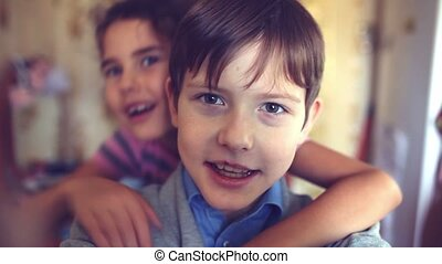 boy girl hugging self shout brother and sister happiness -...