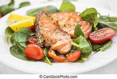 Grilled Salmon with Spinach and Tomatoes Salad,Selective Focus