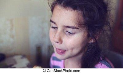 teen eats girl bread with butter tea drinkers breakfast -...