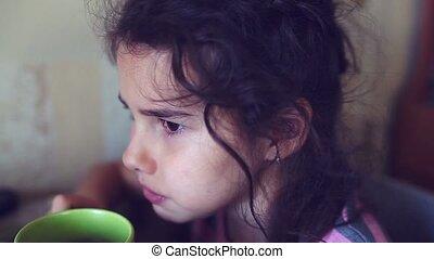 teen girl drinking hot tea mug - teen girl drinking hot tea...
