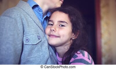 teen girl clung to the boy chest hugging love happiness -...
