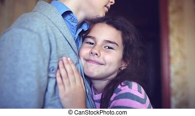 teen girl clung to boy chest hugging love happiness - teen...