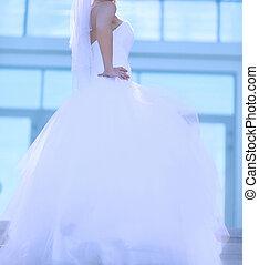 Beautiful bride in wedding dress posing, profile view