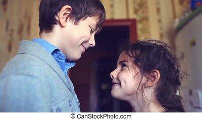 Teen boy looks at girl happiness love friendship - Teen boy...