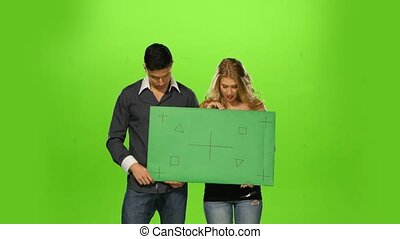 energetic Couple holding up a blank sign, green screen -...