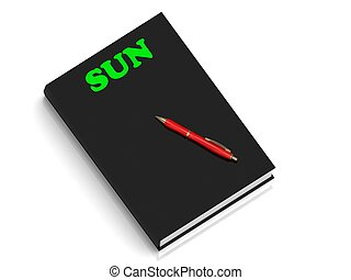 SUN- inscription of green letters on black book on white...