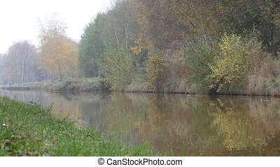Calm river water disturbed by boat - Calm river or canal...