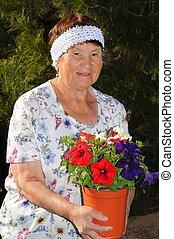 Senior Woman Gardening - A Senior woman tending to a garden