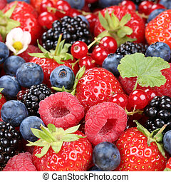 Berry fruits in summer with strawberries, blueberries and raspberries