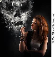 Dangerous smoking - Girl smokes a cigarette forming a skull