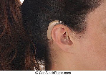 Hearing Aid - Beautiful young woman with Hearing Aid,...