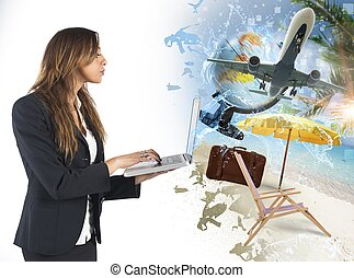 Summer vacation plan - Businesswoman plans with computer her...