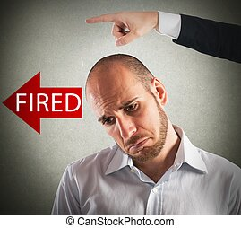 Sad fired businessman - Boss dismisses his sad employee from...