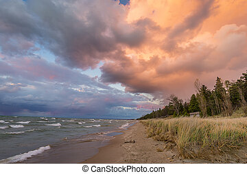 Storm Clouds Over a Lake Huron Beach - Colorful storm clouds...