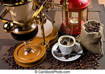 coffee - white cup with hot black coffee and geyser...