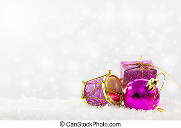 Purple Christmas ornaments against defocused lights...