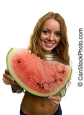 girl holding piece of watermelon
