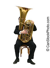 man playing tuba - man sitting on a chair and plays the tuba