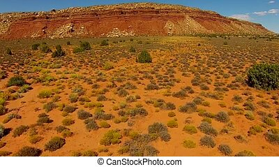 Aerial over the desert - Aerial video flight over empty...