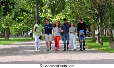Group of students on footpath outdoor. slow motion