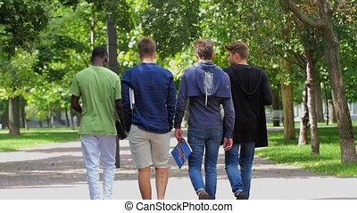 College of students walking together on campus slow motion -...