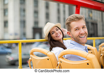 Smiling couple - Happy couple in a tour bus