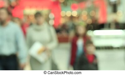 Blurred people in motion, people walking in shopping center,...