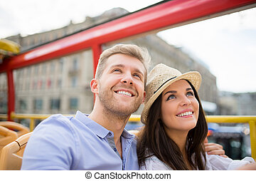Attractive couple - Smiling couple at the tour bus