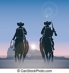 Cowboys silhouettes galloping across the prairie at sunrise....