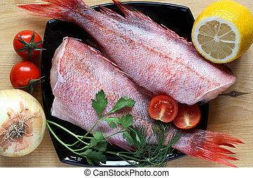Raw Fish For Cooking - Two raw groupers ready for cooking on...