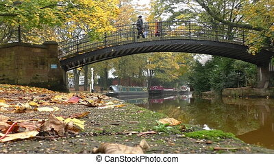 Women on bridge over canal autumn