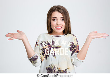 Young woman shrugging shoulders - Portrait of a young woman...