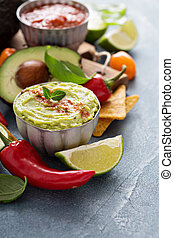Mexican cuisine ingredients and guacamole copy space on gray