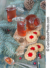 Cookies with bilberry jam - Three glass jars with bilberry...