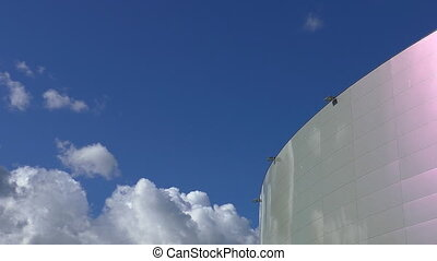 Modern building and bright sky - Top part of a modern round...