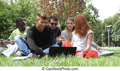 Campus and teenage concept - group of students slow motion -...