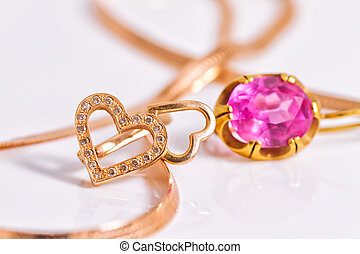 Gold earrings in the shape of a heart and with inset ruby